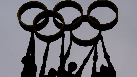 A sculpture representing people carrying the Olympics rings at the IOC's Lausanne offices.