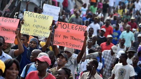 Demonstrators march in the streets of Port-au-Prince, capital of Haiti, on January 25, 2016.