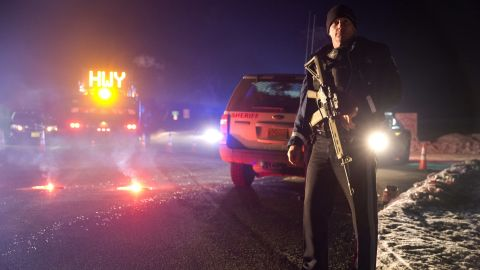 Sgt. Tom Hutchison stands in front of an Oregon State Police roadblock on Highway 395 on Tuesday, January 26, 2016 between John Day and Burns, Oregon.  The FBI on Tuesday arrested the leaders of an armed group that has occupied a federal wildlife refuge in eastern Oregon for the past three weeks.