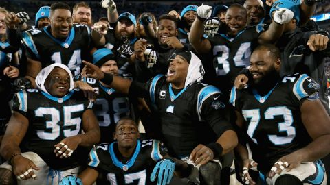 CHARLOTTE, NC - JANUARY 03:  Cam Newton #1 of the Carolina Panthers organizes a team photo in the bench area during their game against the Tampa Bay Buccaneers at Bank of America Stadium on January 3, 2016 in Charlotte, North Carolina.  The Panthers won 38-10 to clinch home field advantage for the playoffs  (Photo by Streeter Lecka/Getty Images)