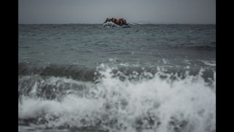 Refugees and migrants onboard a dinghy approach the Greek island of Lesbos after crossing the Aegean Sea from Turkey on Sunday, January 3.