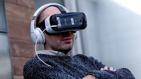 """Actor Paul Scheer watches Funny Or Die's premiere of the first-ever virtual-reality comedy short, """"Interrogation,"""" at Sundance."""
