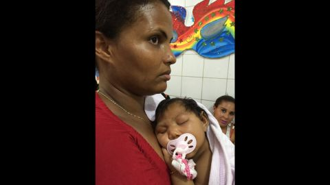 Grandmother Ivanda Dias awaits with baby Ludmilla in her arms the final tests that will confirm the diagnosis of microcephaly.
