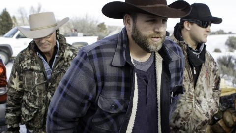 Ammon Bundy makes his way from the entrance of the Malheur National Wildlife Refuge Headquarters in Burns, Oregon on January 6, 2016. A small group of armed activists remained holed up at a remote US federal wildlife refuge in Oregon, vowing to leave only if asked by local residents. AFP PHOTO/ ROB KERR / AFP / ROB KERR        (Photo credit should read ROB KERR/AFP/Getty Images)