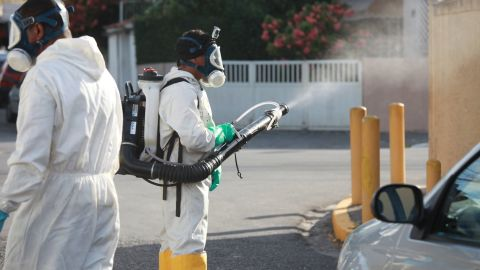 Workers fumigate in the streets of Recife on Tuesday, January 26.