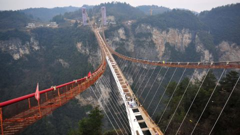 """<a href=""""http://www.haimdotan.com/"""" target=""""_blank"""" target=""""_blank"""">Haim Dotan's</a> Zhangjiajie Canyon Bridge is the largest glass-bottomed bridge in the world. Aside from supporting visitors, the bridge, which is 69 feet long and 718 feet high, will be also be used for bungee jumps and fashion shows."""