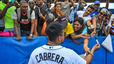 The group met fans at the Latin American Stadium in Havana. Here, Venezuela's Miguel Cabrera signs autographs.