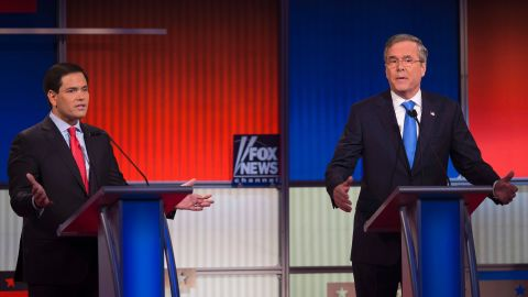 Republican Presidential candidates Florida Senator Marco Rubio (L) and former Florida Gov. Jeb Bush gesture during the Republican Presidential debate sponsored by Fox News at the Iowa Events Center in Des Moines, Iowa on January 28, 2016. / AFP / AFP PHOTO / Jim WATSON        (Photo credit should read JIM WATSON/AFP/Getty Images)