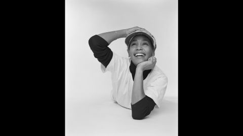 Someone who managed Whitney's mom, gospel singer Cissy Houston, had arranged the shoot and was running late. Whitney asked if she could do her homework, and Mitchell said he didn't mind.