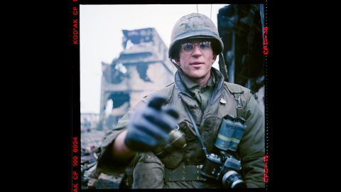 """This self-portrait/exposure test was taken by actor Matthew Modine in November 1985, as he appeared on the set of Stanley Kubrick's """"Full Metal Jacket."""" """"The English weather was getting wet, nasty and cold -- difficult for scenes where you need to believe we are in Vietnam,"""" Modine said. """"I had gloves on because the weather was in the 30s -- too cold for Marine Corps-issue combat fatigues. In the background, you can see one of Beckton Gas Works' large coal bins -- artistically 'destroyed' for Stanley's production."""""""