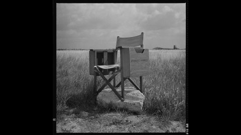 """Kubrick's director's chair sits at Bassingbourn Airfield, England, in 1986. """"I don't know why I stuck it on this chunk of concrete,"""" Modine said. """"I thought it was funny. With Stanley's passing, the image has taken on an unexplainable significance. It is with this photo that I discovered that photographs continue to develop over time."""""""