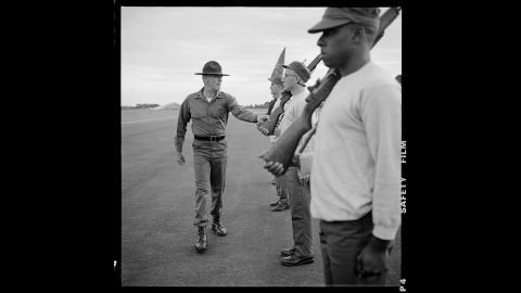 """Ermey inspects his recruits (Howard, center, and Tony Hayes, right) in 1986. The boot camp scenes were physically and emotionally brutal to shoot. Kubrick was intentionally blurring the lines between art and life. """"The scenes were as hard as you imagine,"""" Modine said. """"And the filming of boot camp was around six months. So it was a long journey from shaved heads to graduation day."""""""