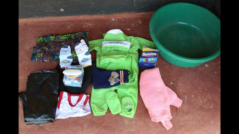 Hazel Shandumba's birth bag includes: baby blanket, cotton wool, a sarong, clothes for the baby, napkins, a basin for water, and a roll of plastic to put on the bed because it is difficult to keep the area clean.
