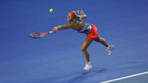 Kerber at full stretch in the thrilling women's singles final against top seed Williams.
