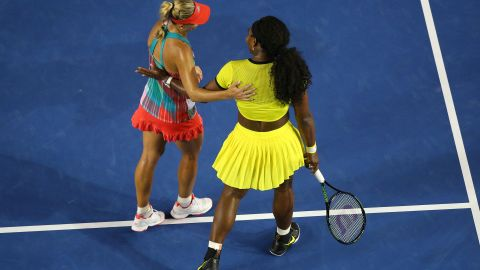 Kerber is sportingly congratulated by Williams after closing out victory in the third set.