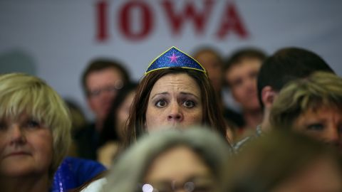 """CEDAR RAPIDS, IA - JANUARY 30:  Supporters look on as democratic presidential candidate former Secretary of State Hillary Clinton speaks during a """"get out to caucus"""" event at Washington High School on January 30, 2016 in Cedar Rapids, Iowa.  With two days to go before the Iowa caucuses, Hillary Clinton is campaigning throughout Iowa.  (Photo by Justin Sullivan/Getty Images)"""