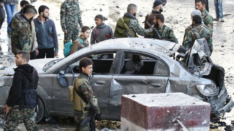 """Syrian pro-government forces gather at the site of a deadly triple bombing Sunday, January 31, in the <a href=""""http://www.cnn.com/2016/01/31/middleeast/syria-damascus-explosions/index.html"""" target=""""_blank"""">Damascus suburb of Sayeda Zeynab</a>. ISIS claimed responsibility for the attack, according to a statement circulating online from supporters of the terrorist group."""