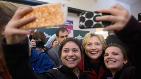 Clinton poses for selfies at her campaign office in Des Moines.