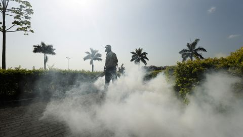 A health ministry worker fumigates the area where carnival celebrations will be held in Panama City on Tuesday, February 2. The Aedes aegypti mosquito carries the Zika virus, which has suspected links to birth defects in newborn children.