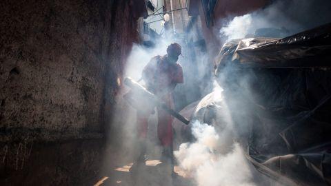 A health worker fumigates an area in Caracas, Venezuela, on Tuesday, February 2.