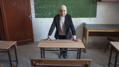 """""""In this image, it is the early morning, and I am waiting in my classroom for my students to arrive. I teach younger children to read and write Arabic. I am strict, but I go out of my way to gently help those students who are having difficulties."""""""