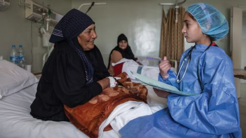 """""""In this image, I am in the future and a well-respected physician at a major hospital in Syria. I am asking a patient about her pain and helping her to get better. My mother was born and raised in a village and didn't go to school, but as a young girl, I had the opportunity to learn and grow into a great doctor."""""""