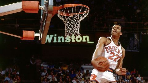 """Larry Nance glides to the rim during the NBA's first Slam Dunk Contest, which was held in Denver on January 28, 1984. Nance defeated """"Dr. J"""" Julius Erving in the finals of a nine-man competition that also included future Hall of Famers Dominique Wilkins and Clyde Drexler. Over the past three decades, the NBA's Slam Dunk Contest has provided some of the most iconic moments in league history, dazzling viewers with its unique blend of athleticism and showmanship. It is traditionally held midseason as part of the league's All-Star Game festivities."""