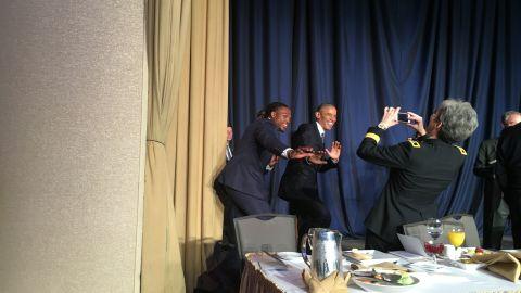 Obama striking the Heisman pose with the most recent Heisman winner Derrick Henry
