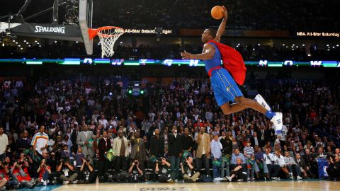 <strong>Dwight Howard (2008):</strong> The 6-foot-11 center donned a Superman cape and jumped high above the rim before throwing the ball through the hoop. It was one of his two perfect 50s in the first round, and he easily won the fan vote to beat Green in the finals. Howard is the tallest person ever to win the event.
