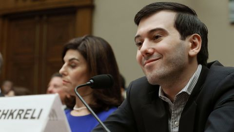 WASHINGTON, DC - FEBRUARY 04: Martin Shkreli, former CEO of Turing Pharmaceuticals LLC., smiles while flanked by Nancy Retzlaff, chief commercial officer for Turing Pharmaceuticals LLC., during a House Oversight and Government Reform Committee hearing on Capitol Hill, February 4, 2016 in Washington, DC. Shkreli invoked his 5th Amendment right not to testify to the committee that is examining the prescription drug market. (Photo by Mark Wilson/Getty Images) *** BESTPIX ***