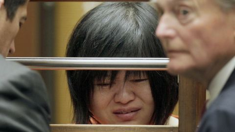 """Dr Hsiu Ying """"Lisa"""" Tseng cries during her arraignment, flanked by attornies, Edward Welbourn, left, and Alan Stokke, Friday, March 16, 2012 in Los Angeles. Tseng, a California doctor, has pleaded not guilty to charges of second-degree murder in the prescription drug overdose deaths of three patients. (AP Photo/Nick Ut)"""