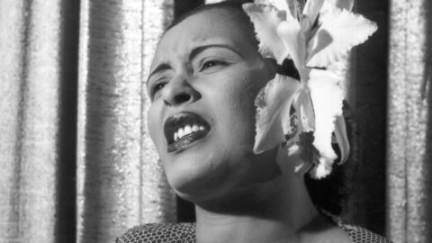 """Despite little formal training, jazz singer <strong>Billie Holiday</strong> (1915-1959) thrilled audiences in the '40s and '50s with her vulnerable voice and inimitable stylings. Her take on Gershwin's """"The Man I Love"""" is a classic. Here she's seen singing with an orchid in her hair in the early 1950s."""