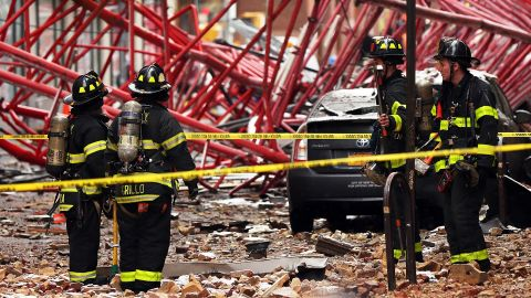 Emergency workers converge at the scene. The accident killed at least one person and injured three others -- two of them seriously, the New York City Fire Department said.