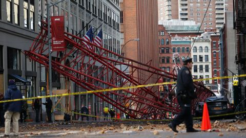 A construction crane lies on a street in Lower Manhattan in New York City on Friday, February 5.
