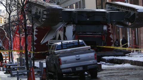 A construction crane lies on a street in Lower Manhattan.