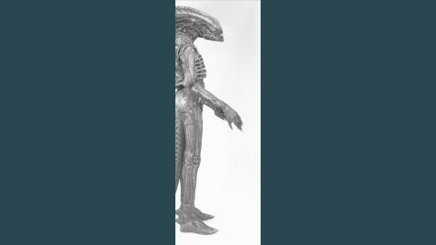 """The costume's tail was controlled separately and made it difficult for Badejo to sit down between takes. When fully fitted, the creature stood seven feet tall -- not ideal considering the set of the spaceship Nostromo was only 6""""7 high."""