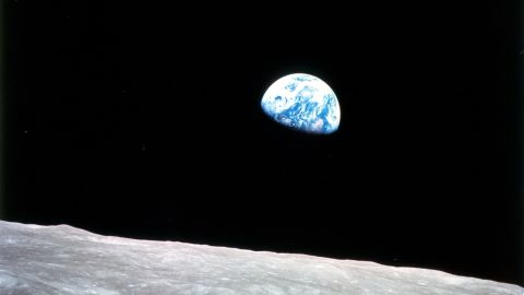 """Apollo 8 launched on December 21, 1968, and entered lunar orbit on Christmas Eve. That night, the crew held a live broadcast and showed pictures of the Earth from their spacecraft. """"The vast loneliness is awe-inspiring and it makes you realize just what you have back there on Earth,"""" Lovell said. They ended the broadcast taking turns reading from the Book of Genesis."""