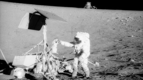 Conrad examines the Surveyor 3, a spacecraft that landed on the moon in 1967. The Apollo 12 crew touched down about 600 feet from the older spacecraft. They collected its television camera and several other pieces and brought them back to Earth.