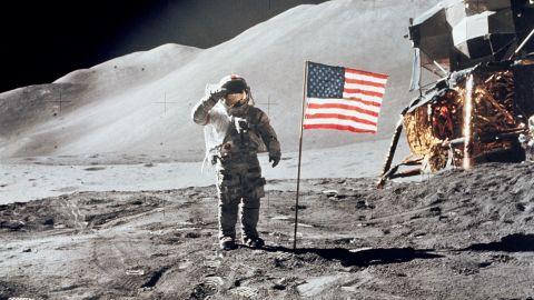 Scott salutes the U.S. flag during an Apollo 15 moonwalk.