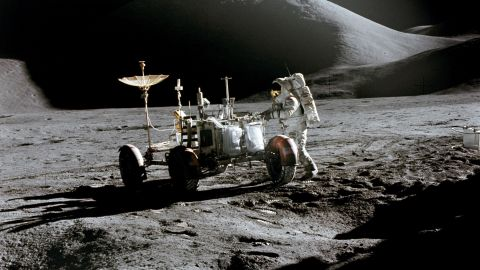 Irwin works near the lunar rover.