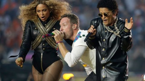 Beyoncé performs with Coldplay's Chris Martin and singer Bruno Mars during the Super Bowl 50 halftime show on February 7, 2016