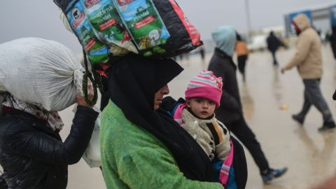 Refugees arrive near the Turkish border as they flee the city of Aleppo on February 6.