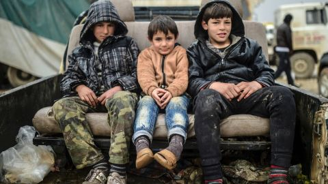 Refugee children sit on a car near the Turkish border crossing on February 6.