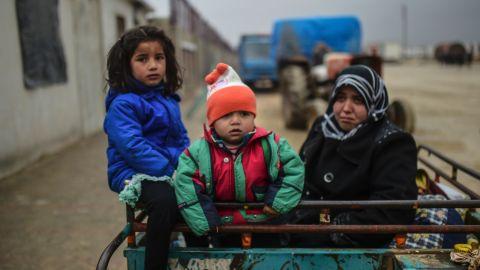 Refugee children arrive at the Turkish border gate on February 6.