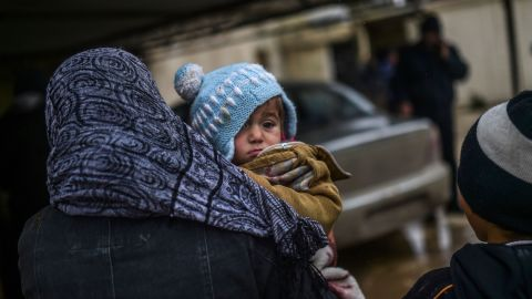 Refugees wait near the Turkish border crossing gate as Syrians fleeing the northern embattled city of Aleppo wait on February 6, 2016 in Bab al-Salama, near the city of Azaz, northern Syria. Thousands of Syrians were braving cold and rain at the Turkish border Saturday after fleeing a Russian-backed regime offensive on Aleppo that threatens a fresh humanitarian disaster in the country's second city. Around 40,000 civilians have fled their homes over the regime offensive, according to the Syrian Observatory for Human Rights monitor. / AFP / BULENT KILIC        (Photo credit should read BULENT KILIC/AFP/Getty Images)
