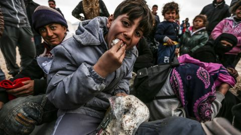 Syrian refugees are pictured in a camp as they flee the city of Aleppo on February 6.