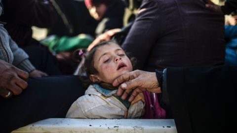 A child sleeps as Syrians fleeing the northern embattled city of Aleppo wait near the Turkish border on February 5, 2016.