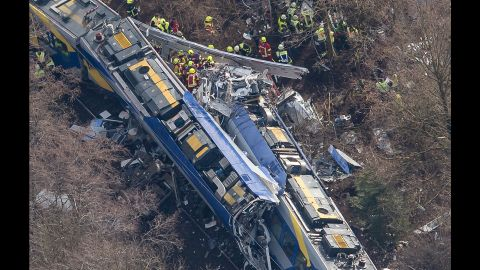 Rescue workers search the site of a deadly train accident near Bad Aibling,Germany, on Tuesday, February 9. Two trains collided in the southern state of Bavaria, police said.