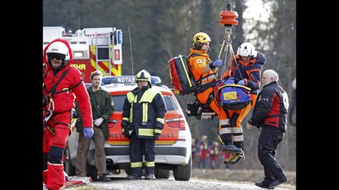 Rescue personnel are airlifted near the wreckage.