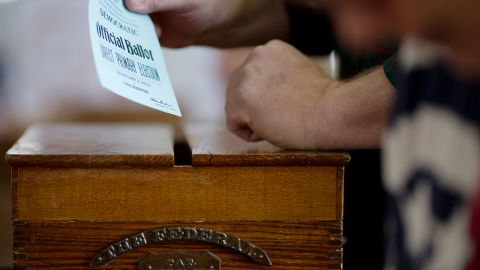 A voter casts their ballot, February 9, 2016, in Chichester, New Hampshire.  New Hampshire voters headed to polls at the snowy break of day Tuesday for the crucial first US presidential primary, with Donald Trump chasing victory and Hillary Clinton looking to narrow the gap on Bernie Sanders. / AFP / DOMINICK REUTER        (Photo credit should read DOMINICK REUTER/AFP/Getty Images)